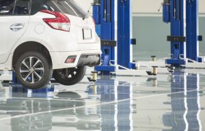 grey and glossy epoxy resin floor coating applied in a garage in australia