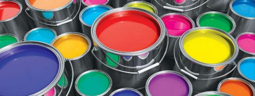 decorative coatings in different colours in open paint cans