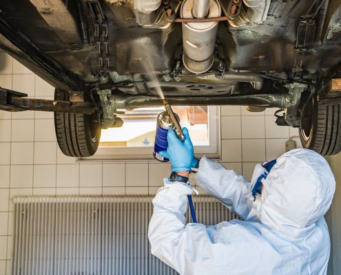 Applying car underbody coatings by spray