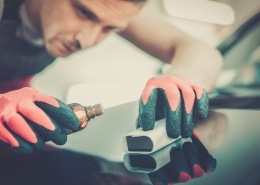 Applying a ceramic car coating.